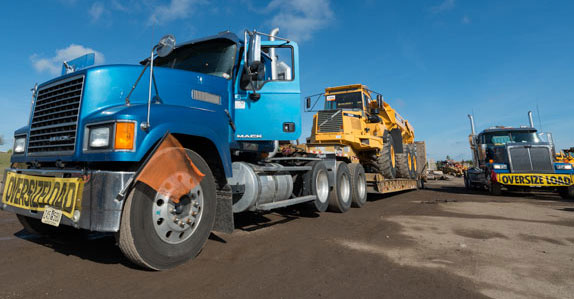shipping heavy equipment truck image